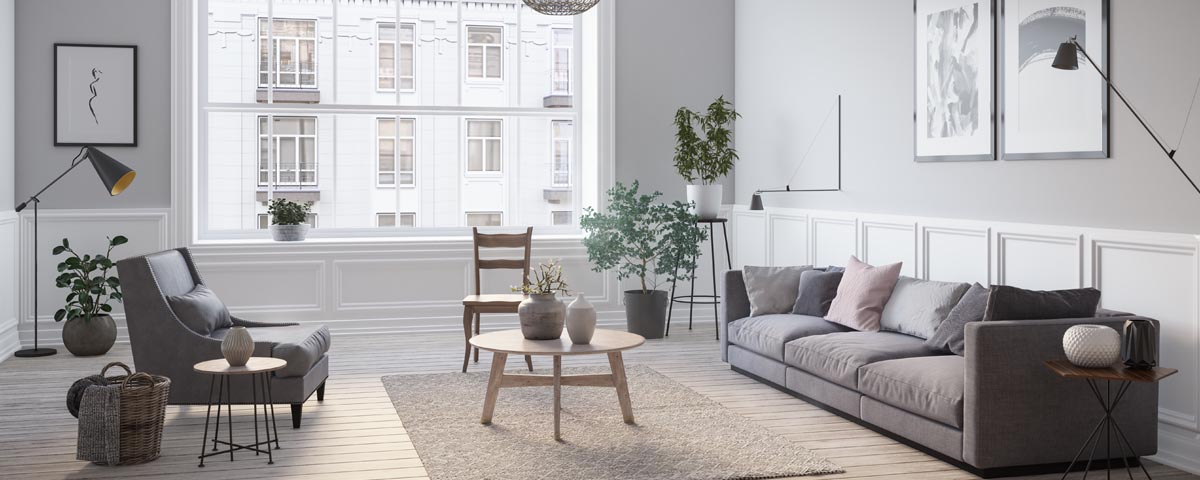 Living room setup with an area rug and soft furniture help with reducing noise in your home
