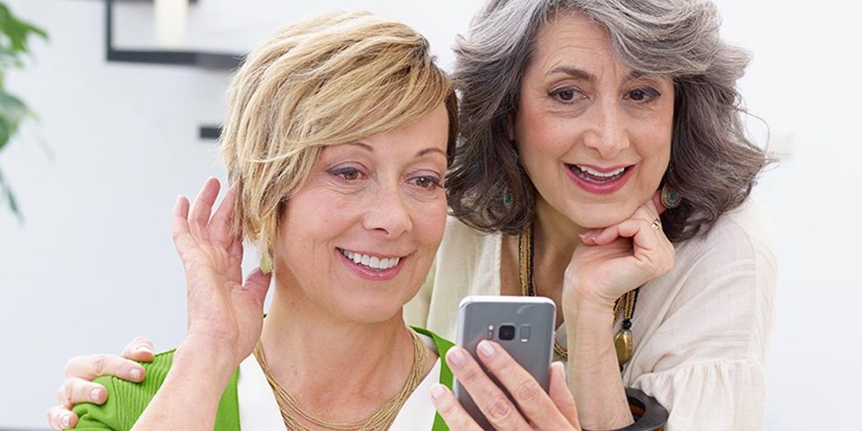 Sara and Ellie test out the direct connection to a smartphone with the new Phonak Marvel hearing aids