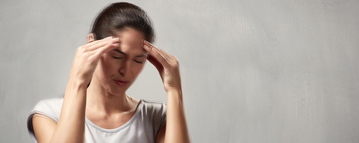Woman experiencing migraine associated vertigo