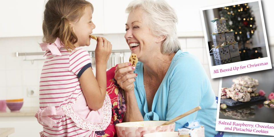 Grandmother and granddaughter baking cookies together