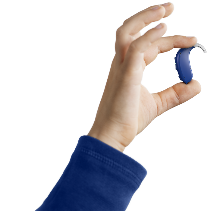 Holding onto a blue Oticon Xceed Play hearing aid
